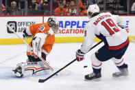 Philadelphia Flyers' goalie Petr Mrazek, left, makes a save on a shot by Washington Capitals' Nicklas Backstrom during the first period of an NHL hockey game, Sunday, March 18, 2018, in Philadelphia. (AP Photo/Derik Hamilton)