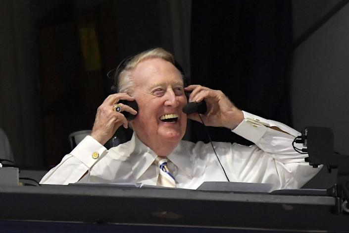 """Dodgers Hall of Fame announcer Vin Scully puts on his headset before a game in September 2016. <span class=""""copyright"""">(Mark J. Terrill / Associated Press)</span>"""
