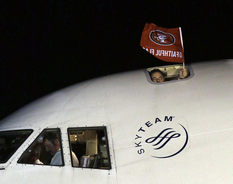 A flag is seen outside the plane carrying the San Francisco 49ers as they arrive at the Louis Armstrong International Airport for the NFL Super Bowl XLVII football game Sunday, Jan. 27, 2013, in New Orleans. (AP Photo/David J. Phillip)