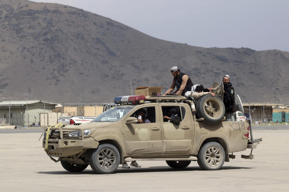 Taliban fighters arrive inside the Hamid Karzai International Airport after the U.S. military's withdrawal, in Kabul, Afghanistan, Tuesday, Aug. 31, 2021. The Taliban were in full control of Kabul's airport on Tuesday, after the last U.S. plane left its runway, marking the end of America's longest war. (AP Photo/Khwaja Tawfiq Sediqi)