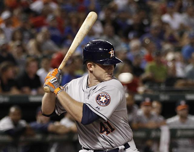 Houston Astros' Max Stassi (41) is hit in the face by a pitch thrown by Texas Rangers reliever Tanner Scheppers during the eighth inning of a baseball game, Wednesday, Aug. 21, 2013, in Arlington, Texas. (AP Photo/Jim Cowsert)