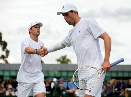 Jun 30, 2016; London, United Kingdom; Bob Bryan (USA) and Mike Bryan (USA) during their doubles match on day four of the 2016 The Championships Wimbledon. Mandatory Credit: Susan Mullane-USA TODAY Sports