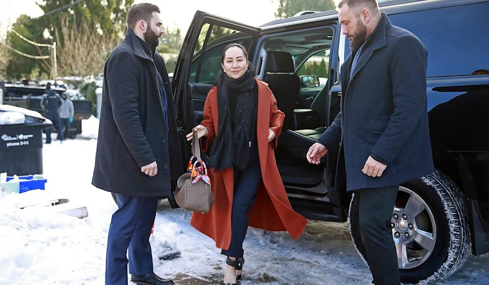 Private security guards from Lions Gate Risk Management escort Meng Wanzhou as she exits her vehicle at her home on January 17, 2020. Photo: AFP