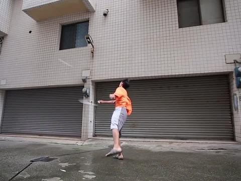 A strong gust of wind in Taiwan provides the perfect opportunity for this guy to play some badminton against himself! Although his efforts are valiant, it looks like nature wins this round.