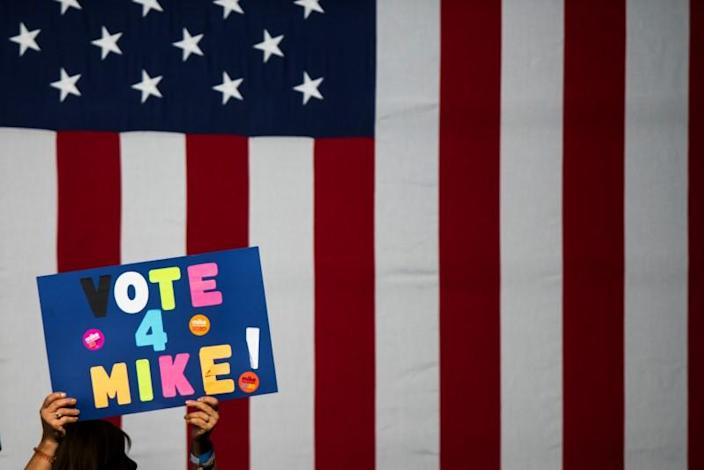 """A woman holds a placard as people attend the campaign event """"Women for Mike"""" by Democratic U.S. presidential candidate Bloomberg in the Manhattan borough of New York City, New York"""