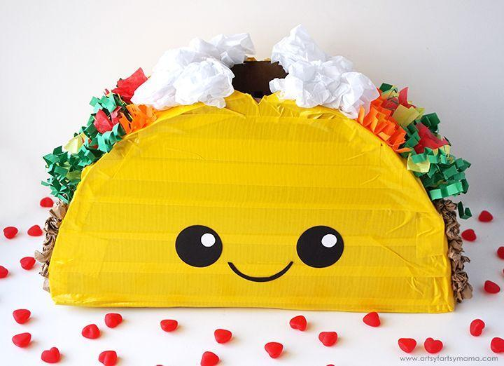 """<p>Is there anything in the entire world cuter than this taco Valentine's box? Yeah, we didn't think so!</p><p><strong>Get the tutorial at </strong><a href=""""https://www.artsyfartsymama.com/2018/02/taco-valentine-card-box.html"""" rel=""""nofollow noopener"""" target=""""_blank"""" data-ylk=""""slk:Artsy Fartsy Mama."""" class=""""link rapid-noclick-resp""""><strong>Artsy Fartsy Mama. </strong></a></p><p><a class=""""link rapid-noclick-resp"""" href=""""https://www.amazon.com/Hallmark-Classic-Rainbow-Flowers-Garland/dp/B07PGKTJBT/?tag=syn-yahoo-20&ascsubtag=%5Bartid%7C2164.g.35119968%5Bsrc%7Cyahoo-us"""" rel=""""nofollow noopener"""" target=""""_blank"""" data-ylk=""""slk:SHOP TISSUE PAPER"""">SHOP TISSUE PAPER</a></p>"""