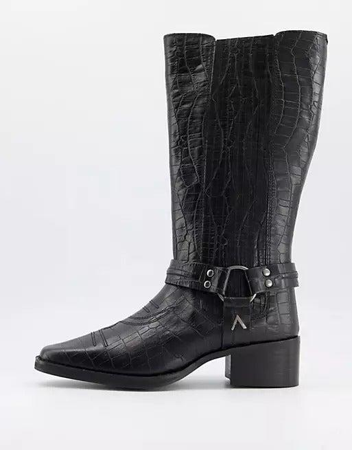 """<br><br><strong>ASRA</strong> Western Knee Boots, $, available at <a href=""""https://www.asos.com/asra/asra-khloe-western-knee-boots-in-croc-embossed-black-leather/prd/21821190?colourwayid=60301958&SearchQuery=cowboy+boots"""" rel=""""nofollow noopener"""" target=""""_blank"""" data-ylk=""""slk:ASOS"""" class=""""link rapid-noclick-resp"""">ASOS</a>"""