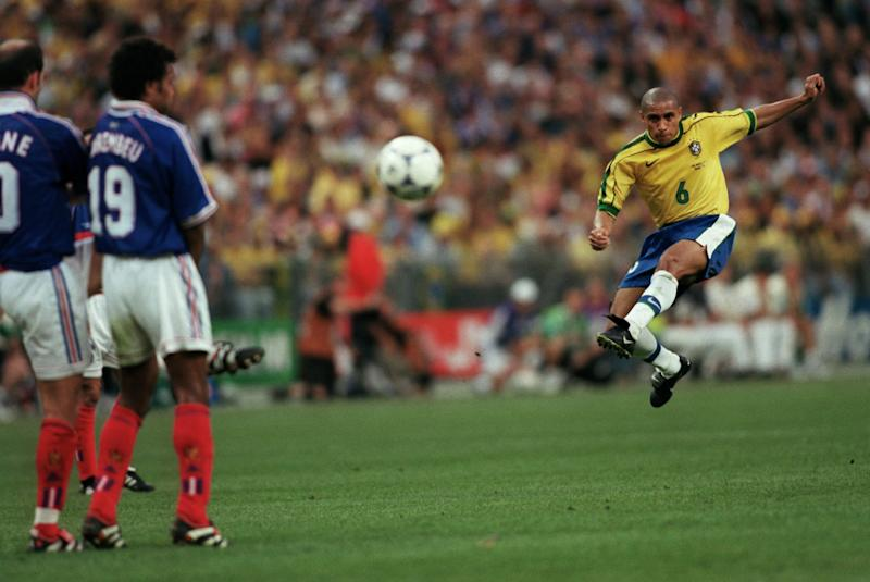 Roberto Carlos curls his free-kick around the France wall (Credit: Getty Images)