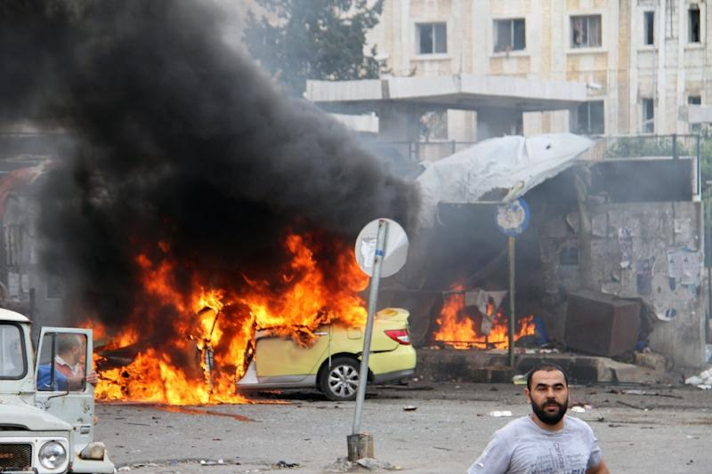 A car in flames at the scene of bombings in the Syrian city of Tartus, northwest of Damascus, on May 23, 2016