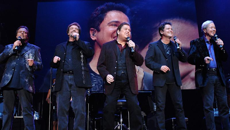 The Osmonds perform during their 50th anniversary tour at Wembley Arena in 2008 (Credit: Samir Hussein/Getty Images)