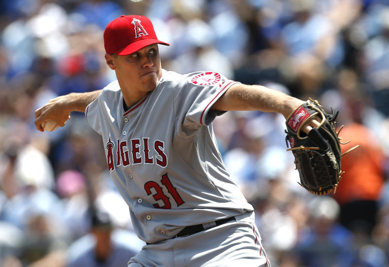 Los Angeles Angels relief pitcher Billy Buckner (31) delivers to a Kansas City Royals batter during the first inning of a baseball game at Kauffman Stadium in Kansas City, Mo., Saturday, May 25, 2013. (AP Photo/Orlin Wagner)