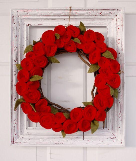 """<p>Felt rosettes are the key to this stunning faux rose wreath, but we love the addition of the distressed white frame, which plays off the rich red beautifully.</p><p><strong>Get the tutorial at <a href=""""https://www.deliacreates.com/valentine-rosette-wreath/"""" rel=""""nofollow noopener"""" target=""""_blank"""" data-ylk=""""slk:Delia Creates"""" class=""""link rapid-noclick-resp"""">Delia Creates</a>.</strong></p><p><a class=""""link rapid-noclick-resp"""" href=""""https://www.amazon.com/red-felt/s?k=red+felt&tag=syn-yahoo-20&ascsubtag=%5Bartid%7C10050.g.35057743%5Bsrc%7Cyahoo-us"""" rel=""""nofollow noopener"""" target=""""_blank"""" data-ylk=""""slk:SHOP RED FELT"""">SHOP RED FELT</a></p>"""