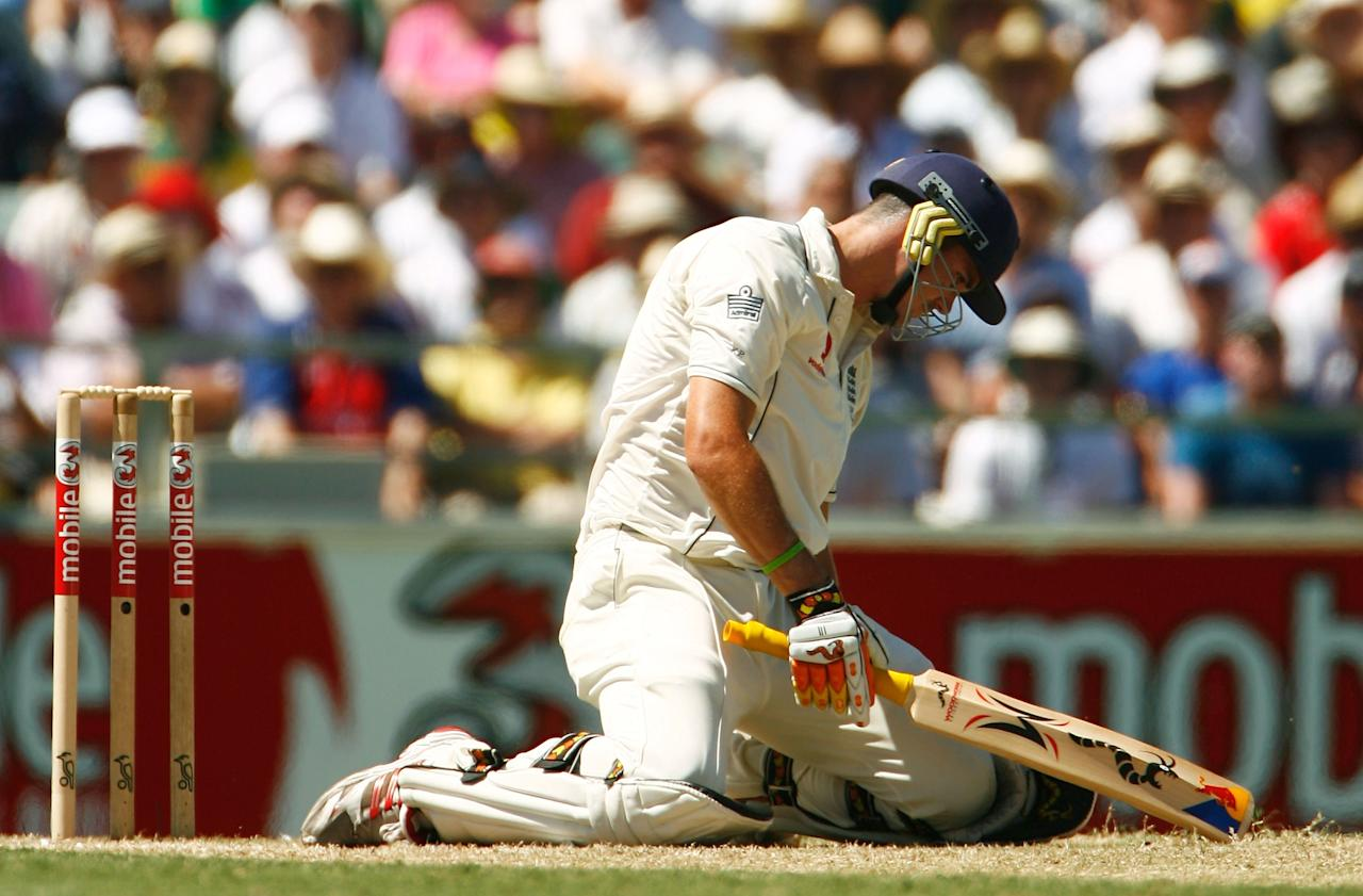 PERTH, AUSTRALIA - DECEMBER 15:  Kevin Pietersen of England sinks to his knees after being caught by Andrew Symonds of Australia off the bowling of Brett Lee of Australia during day two of the third Ashes Test Match between Australia and England at the WACA on December 15, 2006 in Perth, Australia.  (Photo by Tom Shaw/Getty Images)
