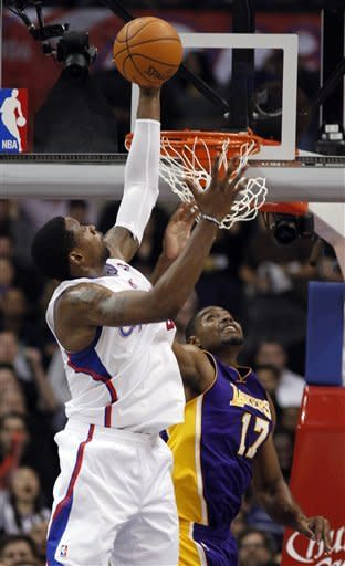 Los Angeles Clippers center DeAndre Jordan, left, grabs a rebound against Los Angeles Lakers center Andrew Bynum (17) during the first half of an NBA preseason basketball game in Los Angeles, Wednesday, Dec. 21, 2011. (AP Photo/Alex Gallardo)