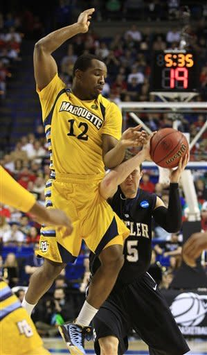 Butler guard Rotnei Clarke (15) shoots against Marquette guard Derrick Wilson (12) in the first half of a third-round NCAA college basketball tournament game on Saturday, March 23, 2013, in Lexington, Ky. (AP Photo/James Crisp)
