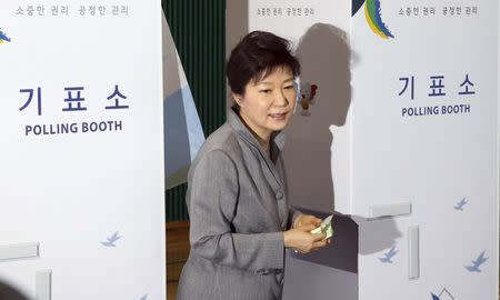 South Korean President Park Geun-hye walks out a voting booth after marking her ballots for the local elections at a polling station in Seoul June 4, 2014. REUTERS/Do Kwang-hwan/Yonhap
