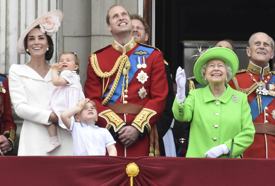Members of the royal family, including Catherine, Duchess of Cambridge holding Princess Charlotte, Prince George, Prince William, Queen Elizabeth, and Prince Philip watch a flypast as they stand on the balcony of Buckingham Palace after the annual Trooping the Colour ceremony on Horseguards Parade in central London, Britain June 11, 2016. Trooping the Colour is a ceremony to honour Queen Elizabeth's official birthday. The Queen celebrates her 90th birthday this year.   REUTERS/Toby Melville