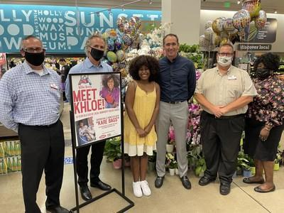 """Executives from Ralphs, Empire Brokerage, and FoodStory Brands presented 14-year-old Khloe Thompson with $9,000, which she used to compile more than 300 """"Kare Bags"""" for the homeless in Los Angeles via her nonprofit Khloe Kares."""