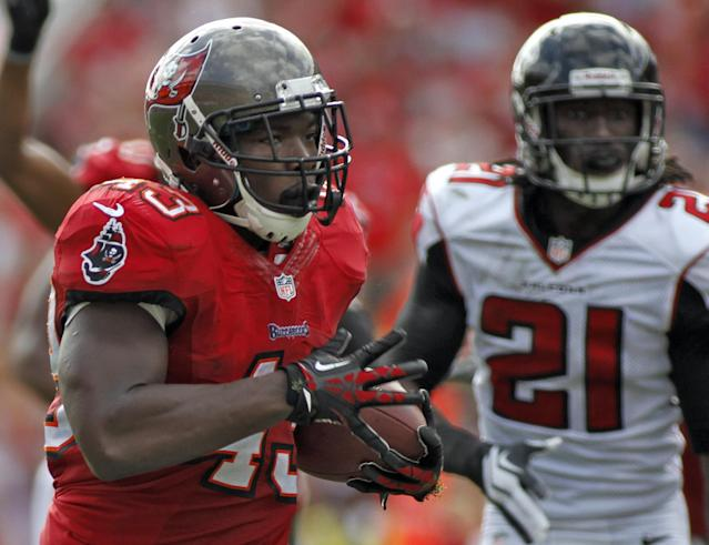 Tampa Bay Buccaneers running back Bobby Rainey (43) outruns Atlanta Falcons cornerback Desmond Trufant (21) to the end zone to score on a 43-yard touchdown run during the second quarter of an NFL football game on Sunday, Nov. 17, 2013, in Tampa, Fla. (AP Photo/Reinhold Matay)