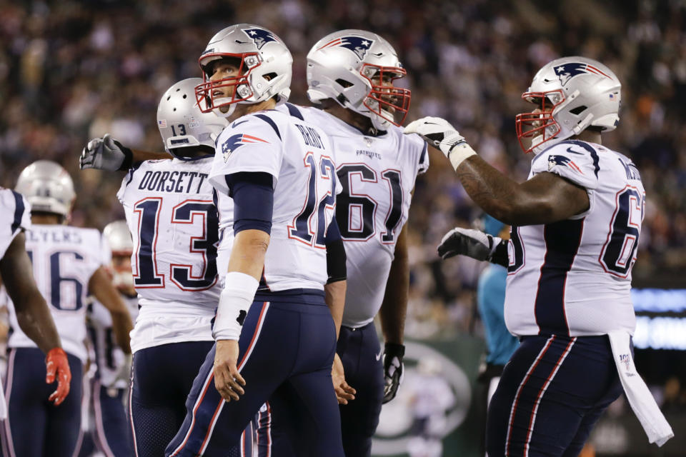 New England Patriots' Tom Brady (12) celebrates with Phillip Dorsett (13) after they connected for a touchdown during the first half of an NFL football game against the New York Jets, Monday, Oct. 21, 2019, in East Rutherford, N.J. (AP Photo/Adam Hunger)