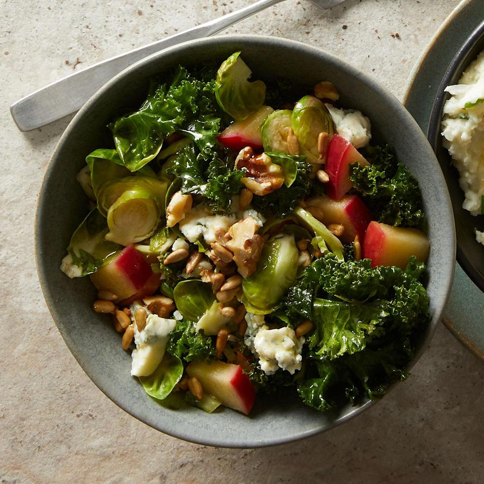 <p>Massaging kale, curly endive and Brussels sprouts then tossing with a warm dressing wilts them slightly for a more tender bite.</p>
