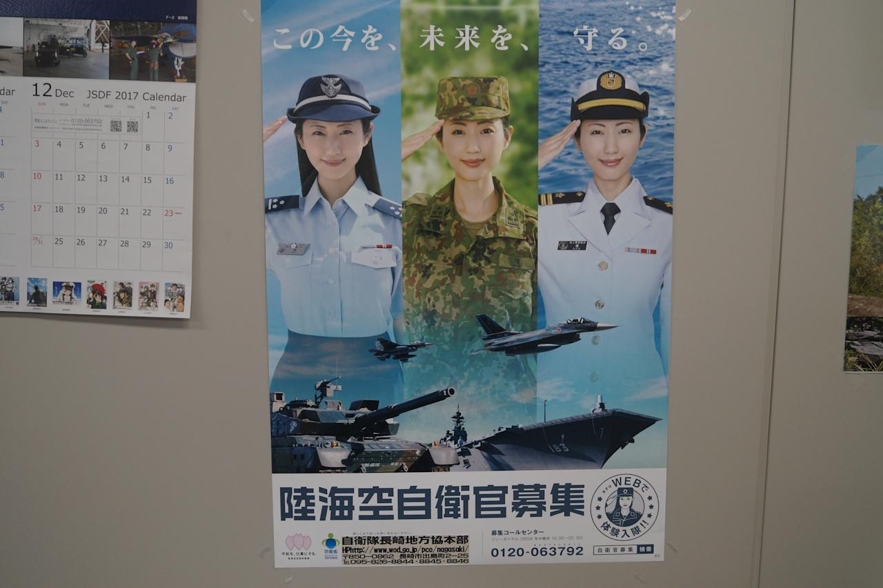 <p>A recruitment poster for the Self-Defense Forces featuring Japanese actress and model Mitsu Dan was on display in various military and government buildings. (Photo: Michael Walsh/Yahoo News) </p>