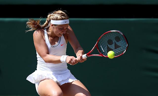 Germany's Sabine Lisicki in action against France's Marion Bartoli during day twelve of the Wimbledon Championships at The All England Lawn Tennis and Croquet Club, Wimbledon.