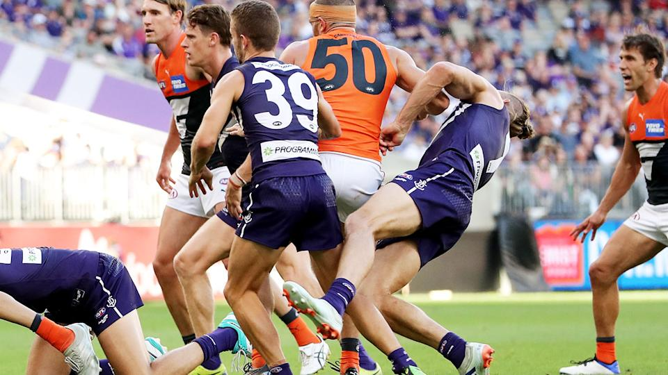 Nat Fyfe, pictured here copping a brutal hit from Sam Reid in Fremantle's win over GWS.