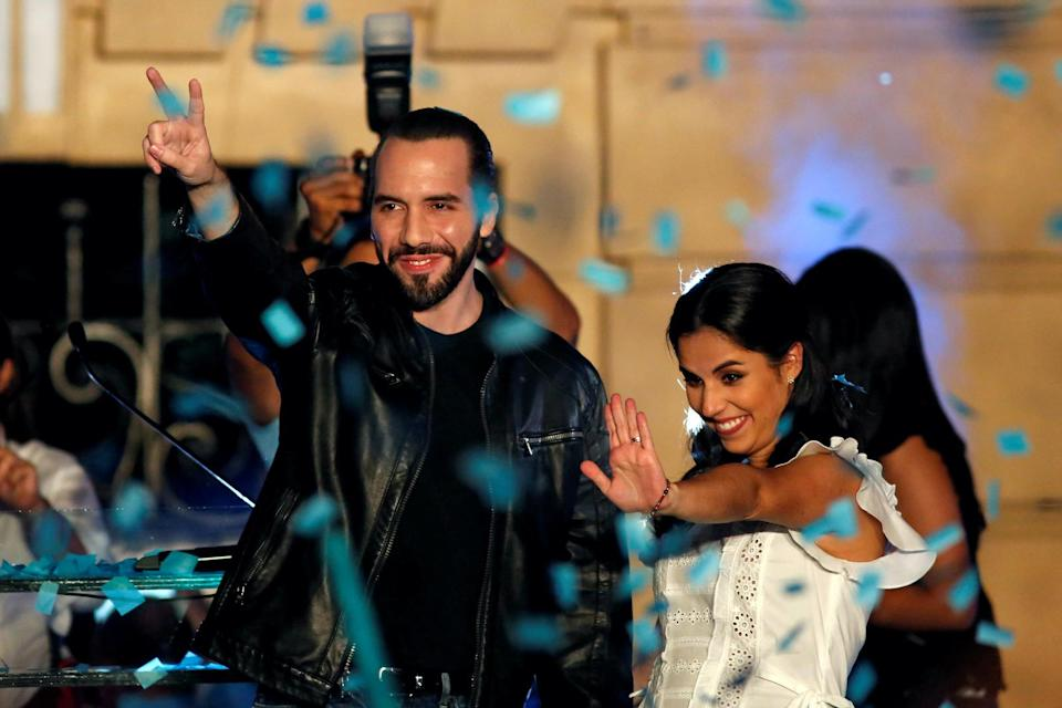 Presidential candidate Nayib Bukele of the Great National Alliance (GANA) and his wife Gabriela de Bukele gesture as they celebrate with supporters after the first official presidential election results were released in San Salvador, El Salvador, February 3, 2019. REUTERS/Jose Cabezas     TPX IMAGES OF THE DAY - RC18F771A610