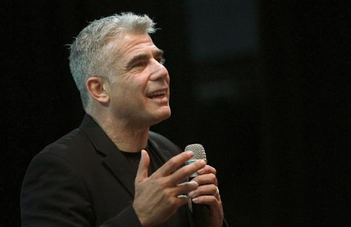 Israeli MP and chairperson of center-right Yesh Atid party, Yair Lapid, delivers a speech during election campaign at the Israeli city of Modiin near Tel Aviv on March 15, 2015 (AFP Photo/Gil Cohen Magen)