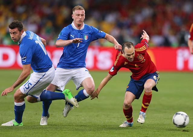 KIEV, UKRAINE - JULY 01: Ignazio Abate (C) of Italy pulls the shirt of Andres Iniesta (R) of Spain during the UEFA EURO 2012 final match between Spain and Italy at the Olympic Stadium on July 1, 2012 in Kiev, Ukraine. (Photo by Alex Livesey/Getty Images)