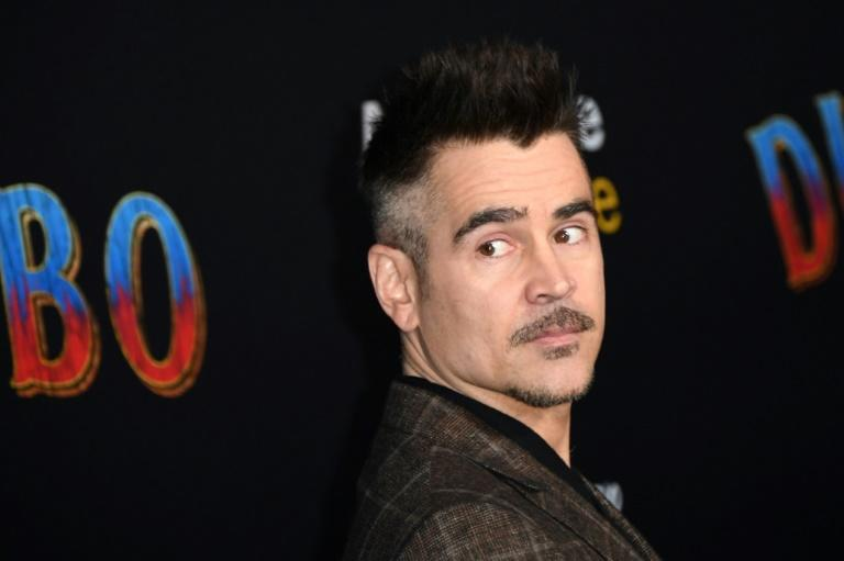 Colin Farrell, pictured at the premier, plays a World War I veteran and widower who has lost an arm in battle