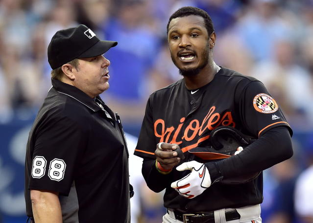 Adam Jones (right) and several of his Orioles teammates had a night they'll never forget after being in an elevator for 30 minutes following a loss to in Toronto. (AP)