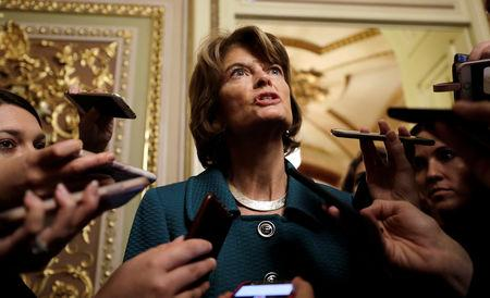 U.S. Senator Murkowski talks to reporters about her no vote on Kavanaugh nomination vote on Capitol Hill in Washington