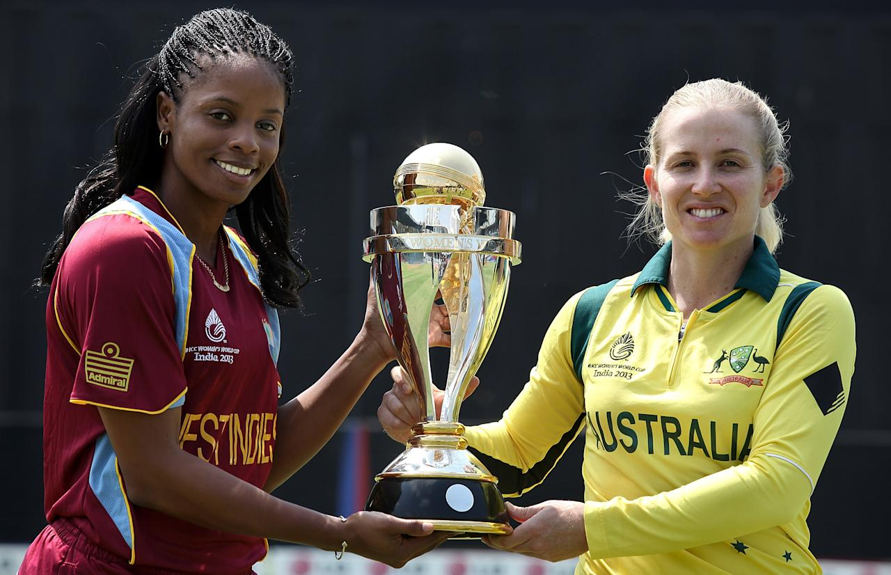 MUMBAI, INDIA - FEBRUARY 16:  Merissa Aguilleira, captain of West Indies and Jodie Fields, captain of Australia holding the trophy at the Cricket Club of India ground ahead of tomorrows ICC Womens World Cup Final between Australia and West Indies on February 16, 2013 in Mumbai, India. (Photo by Graham Crouch/ICC via Getty Images)