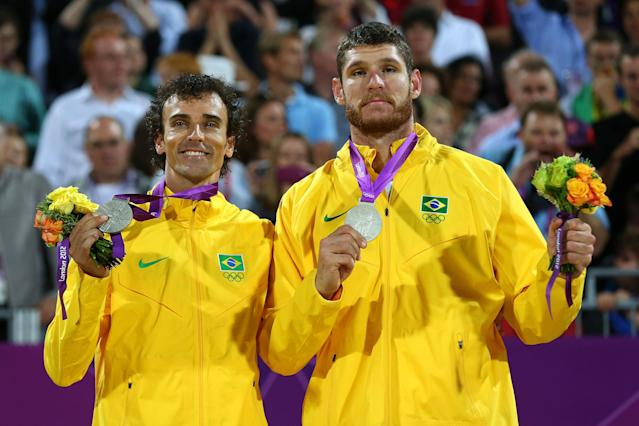 LONDON, ENGLAND - AUGUST 09: Silver medalists Emanuel Rego and Alison Cerutti of Brazil celebrate with their medals during the medal ceremony for the Men's Beach Volleyball on Day 13 of the London 2012 Olympics Games at Horse Guard's Parade on August 9, 2012 in London, England. (Photo by Ryan Pierse/Getty Images)
