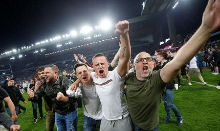 Soccer Football - Championship Play Off Semi Final Second Leg - Aston Villa v Middlesbrough - Villa Park, Birmingham, Britain - May 15, 2018 Aston Villa fans invade the pitch after the game Action Images via Reuters/Ed Sykes