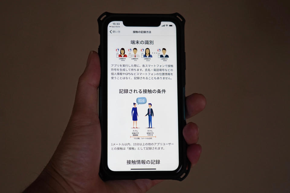 The smartphone screen, seen in Yokohama, Japan, shows a trial version of the COVID-19 Contact Confirming Application, or COCOA, released Friday, June 19, 2020, by the Ministry of Health, Labor and Welfare. The notice explains how to record the history of the user's contacts. The coronavirus tracing app is designed to alert users if they come in contact with someone tested positive for the coronavirus. Once installed, the app logs data via Bluetooth from phones that stay in close proximity for over 15 minutes. (AP Photo)
