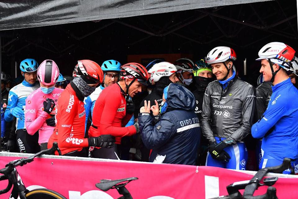 ASTI ITALY  OCTOBER 23 Start  Wilco Kelderman of The Netherlands and Team Sunweb Pink Leader Jersey  Adam Hansen of Australia and Team Lotto Soudal  Nathan Haas of Australia and Team Cofidis Solutions Credits  Ignatas Konovalovas of Lithuania and Team Groupama  FDJ  Miles Scotson of Australia and Team Groupama  FDJ  Protected from the heavy rain and in talks about the possible cancellation of the stage due to rain  Morbegno Village  during the 103rd Giro dItalia 2020 Stage 19 a 258km stage from Morbegno to Asti  girodiitalia  Giro  on October 23 2020 in Asti Italy Photo by Stuart FranklinGetty Images