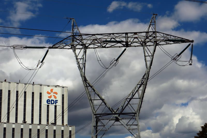 FILE PHOTO: Electrical power pylons of high-tension electricity power lines are seen next to the EDF power plant in Bouchain