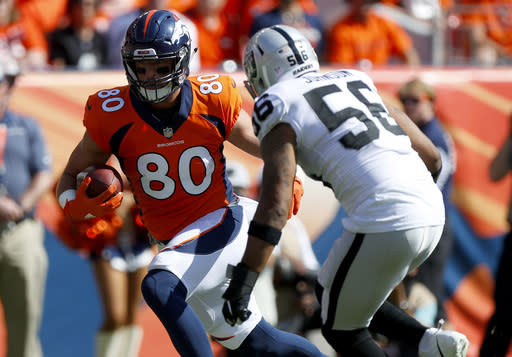 FILE - In this Sept. 16, 2018, file photo, Oakland Raiders linebacker Derrick Johnson (56) hits Denver Broncos tight end Jake Butt (80) during the first half of an NFL football game, Sunday, Sept. 16, 2018, in Denver. Butt tore his left ACL during a walkthrough practice Thursday, Sept. 27, 2018, and is headed for injured reserve for the second straight season. (AP Photo/Jack Dempsey, File)
