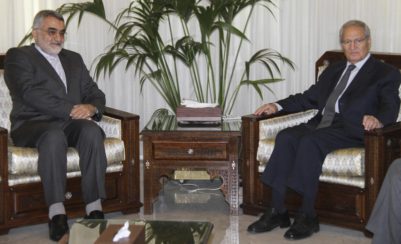 Alaeddin Boroujerdi, left, head of Iran's powerful parliamentary committee on national security and foreign policy meets with Syrian Vice President Farouk Al-Sharaa , ending rumors that Al-Sharaa had defected to Jordan in Damascus, Syria, Sunday, August 26, 2012. Al-Sharaa's defection would have been a blow to Bashar Assad's regime but Jordan and Al-Sharaa's office had repeatedly denied that he defected. (AP Photo/Bassem Tellawi)