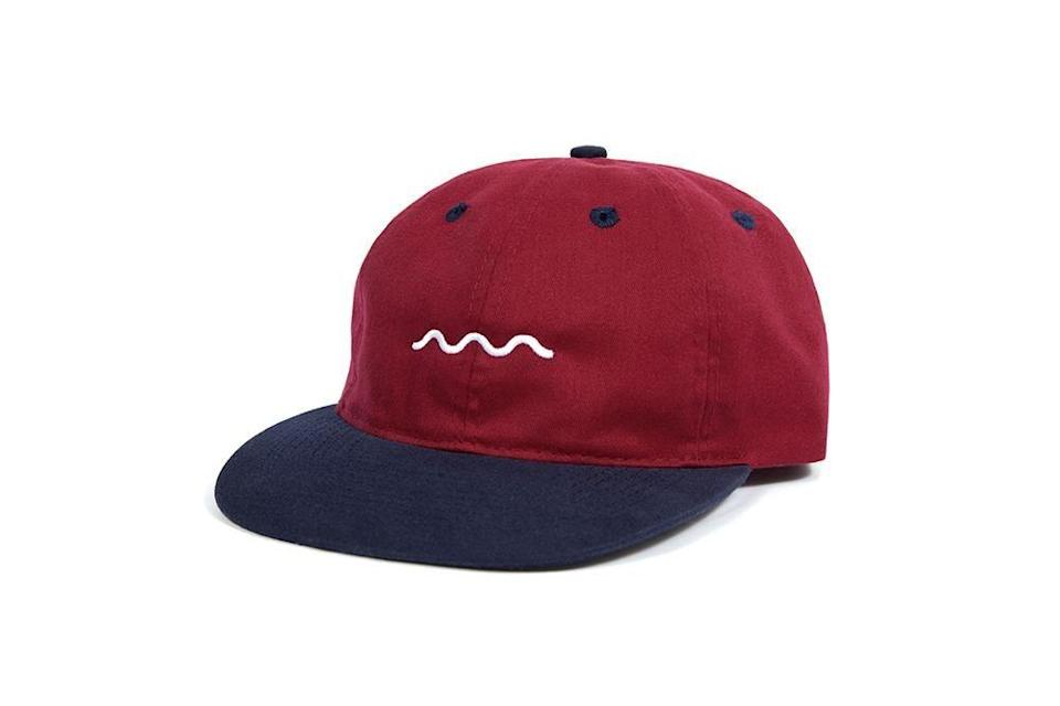"<p><strong>The Good Company</strong></p><p>97allen.com</p><p><strong>$40.00</strong></p><p><a href=""https://www.97allen.com/collections/front-page/products/chill-wave-snapback-navy-burgundy"" rel=""nofollow noopener"" target=""_blank"" data-ylk=""slk:Shop Now"" class=""link rapid-noclick-resp"">Shop Now</a></p><p>The Good Company is best known for eye-catching graphic tees, but this cotton cap is a head above the rest. It's understated and casually cool, just like him.</p>"