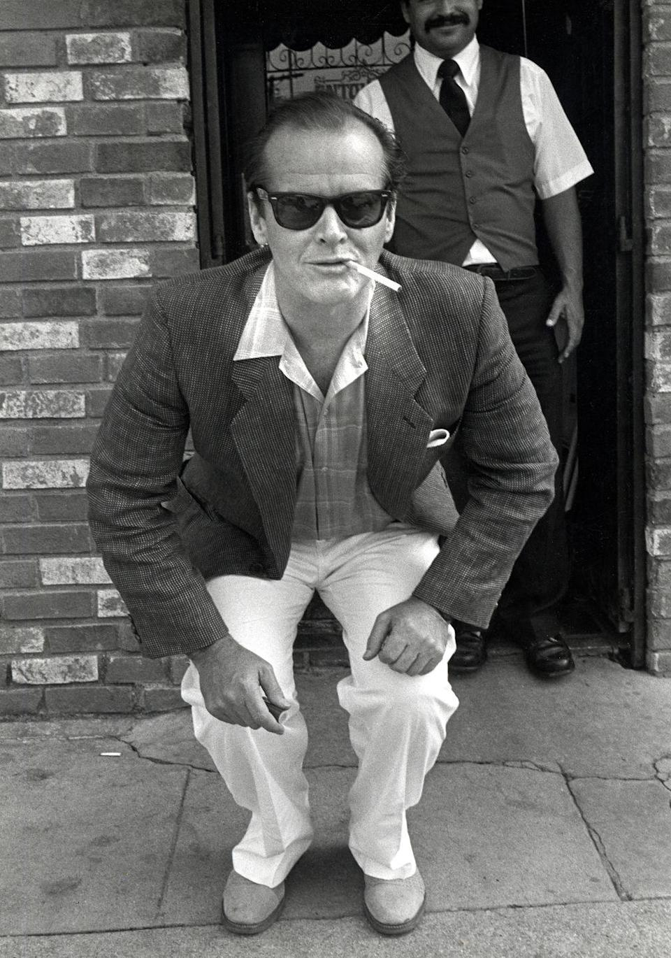 <p>Jack Nicholson perched with his cigarette at Hollywood's Record Plant in 1983. </p>
