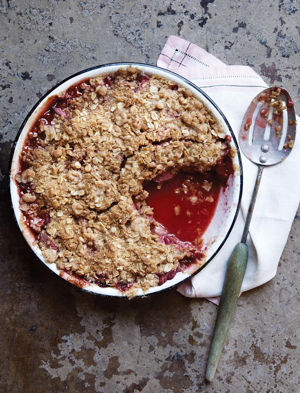 """The tender sweetness of summer-fresh strawberries paired with chunks of cherry-red rhubarb creates our favorite sweet-and-sour dessert. The buttery oatmeal topping adds a rustic goodness as the fruit juices bubble up through the crisp and over the sides. <a href=""""https://www.epicurious.com/recipes/food/views/strawberry-rhubarb-crisp-back-in-the-day?mbid=synd_yahoo_rss"""" rel=""""nofollow noopener"""" target=""""_blank"""" data-ylk=""""slk:See recipe."""" class=""""link rapid-noclick-resp"""">See recipe.</a>"""