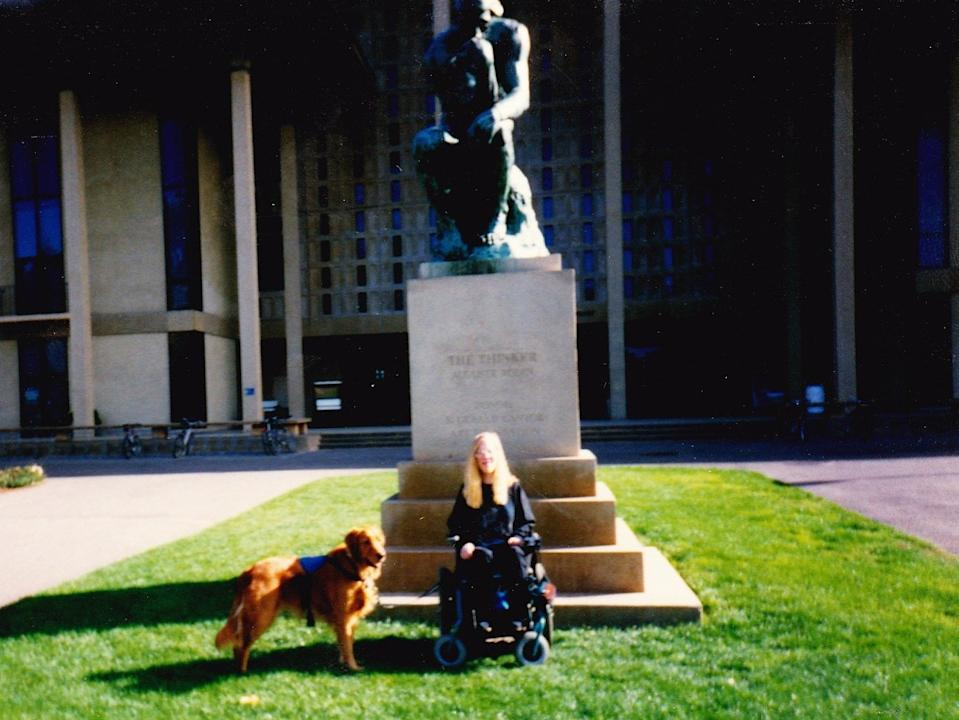 """Karin poses in front of """"The Thinker"""" while a student at Stanford University."""