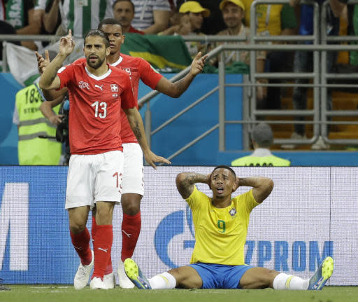 Switzerland's Ricardo Rodriguez, left, and Brazil's Gabriel Jesus, right, react during the group E match between Brazil and Switzerland at the 2018 soccer World Cup in the Rostov Arena in Rostov-on-Don, Russia, Sunday, June 17, 2018. (AP Photo/Themba Hadebe)