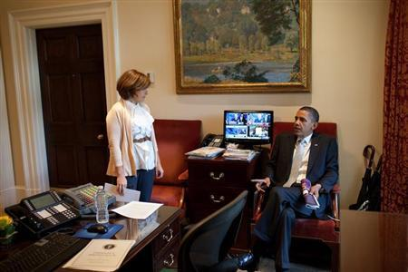 Handout photograph of U.S. President Obama talking with Director of Scheduling and Advance Mastromonaco in the Outer Oval Office in Washington
