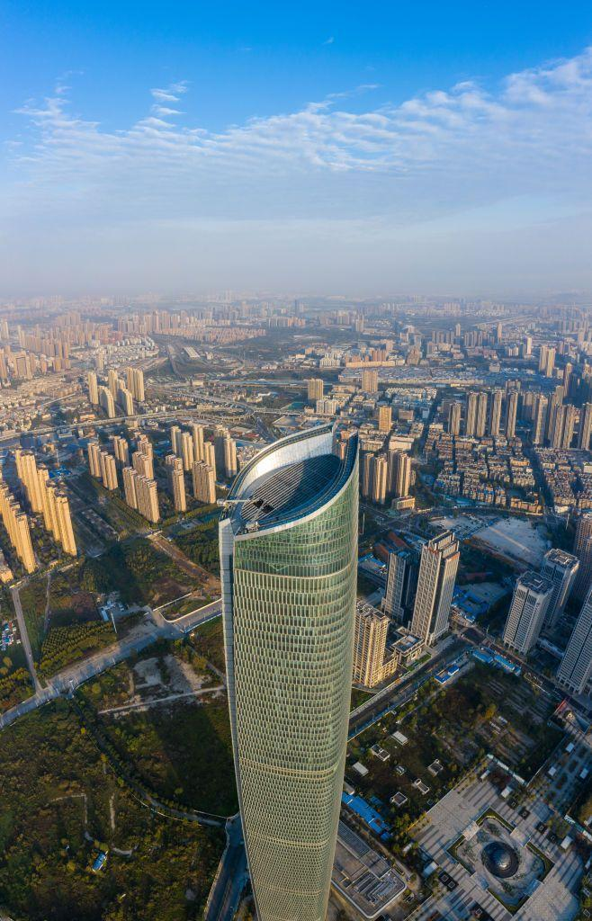<p><strong>Location:</strong> Wuhan, China</p><p><strong>Height:</strong> 1,437 feet</p><p><strong>Completion Date:</strong> 2019</p><p>Construction on the Wuhan Center (not to be confused with the Wuhan Greenland Center) began in 2011. The building, which is located next to Mengze Lake along the Yangzhi River and is split into five vertical portions, features 88 floors above ground, four below it, and is home to hotel rooms, residential units, and office space. The inspiration for the look of the building was a ship </p>