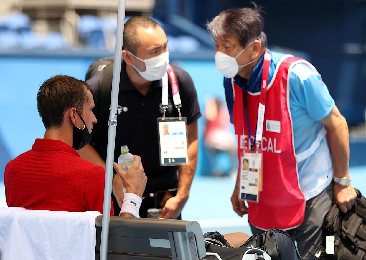 Daniil Medvedev receives medical attention during his Men's Singles Third Round match against Fabio Fognini of Team Italy on day five of the Tokyo 2020 Olympic Games at Ariake Tennis Park on July 28.